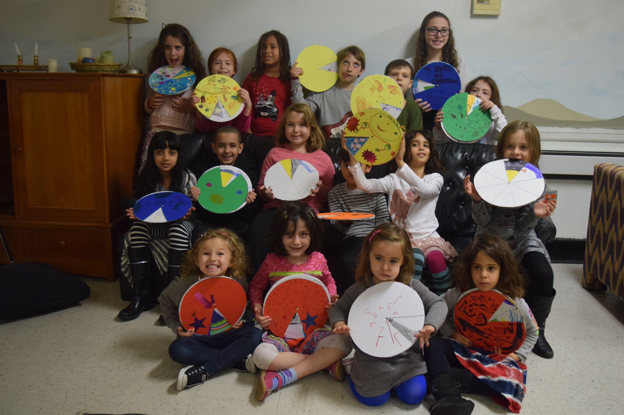 Room J kids with creation wheel
